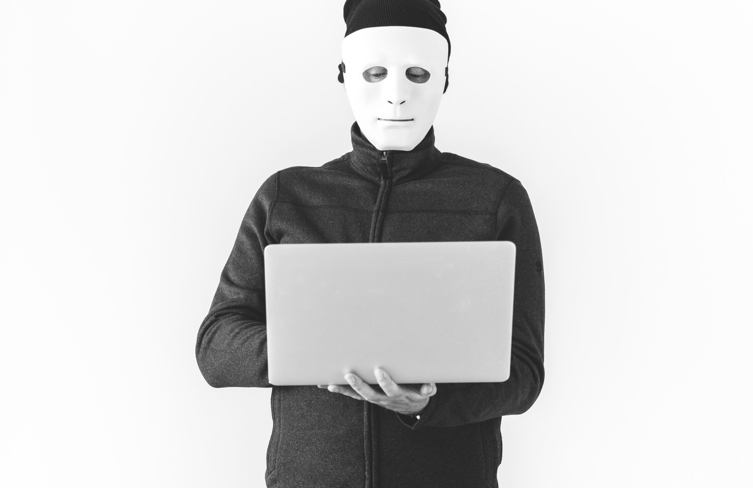 Masked Hacker with laptop
